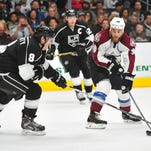 April 4, 2015; Los Angeles, CA, USA; Colorado Avalanche center Ryan O'Reilly (90) moves the puck against Los Angeles Kings defenseman Drew Doughty (8) during the third period at Staples Center. Mandatory Credit: Gary A. Vasquez-USA TODAY Sports