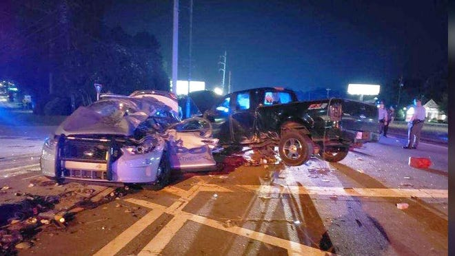 Athens-Clarke police Sgt. Paul Davidson was trapped unconscious in his patrol unit after it was hit by a pickup in this photo posted by his wife on Facebook.
