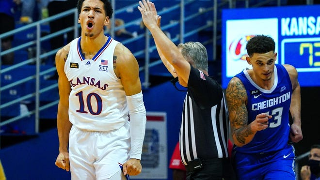 Kansas forward Jalen Wilson, left, celebrates after hitting a go-ahead 3 during the final minute of Tuesday's game against Creighton at Allen Fieldhouse in Lawrence. Wilson had 23 points and 10 rebounds in the 73-72 victory.