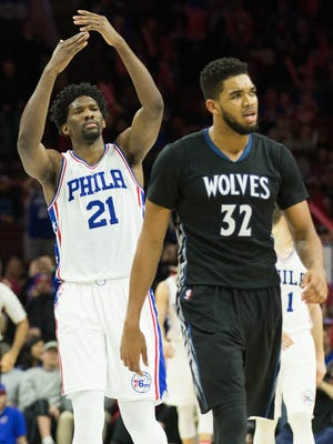 Minnesota Timberwolves center Karl-Anthony Towns (32) reacts after being called for a technical foul as Philadelphia 76ers center Joel Embiid (21) gestures behind him during the third quarter at Wells Fargo Center.
