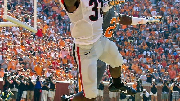 Georgia's Chris Conley (31) makes a touchdown catch in front of Tennessee's Justin Coleman (27) in the first half of an NCAA college football game in Knoxville, Tenn., Saturday, Oct. 5, 2013. (AP Photo/Atlanta Journal-Constitution, Jason Getz)  MARIETTA DAILY OUT; GWINNETT DAILY POST OUT; LOCAL TV OUT; WXIA-TV OUT; WGCL-TV OUT