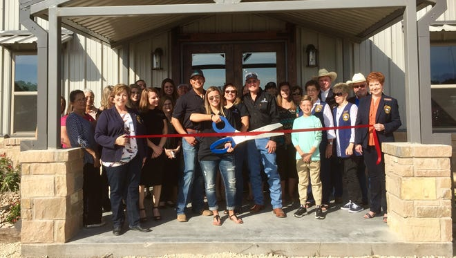 The Concho Cadre helped Kelley De La Rosa, seen here with scissors, and her family celebrate the grand opening of Vista Cielo Rosa, located at 19060 US Highway 277  South in Christoval. The venue is available for weddings and other events.