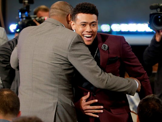 Wade Baldwin IV is congratulated by supporters after being selected 17th overall by the Memphis Grizzlies during the NBA basketball draft, Thursday, June 23, 2016, in New York. (AP Photo/Frank Franklin II)