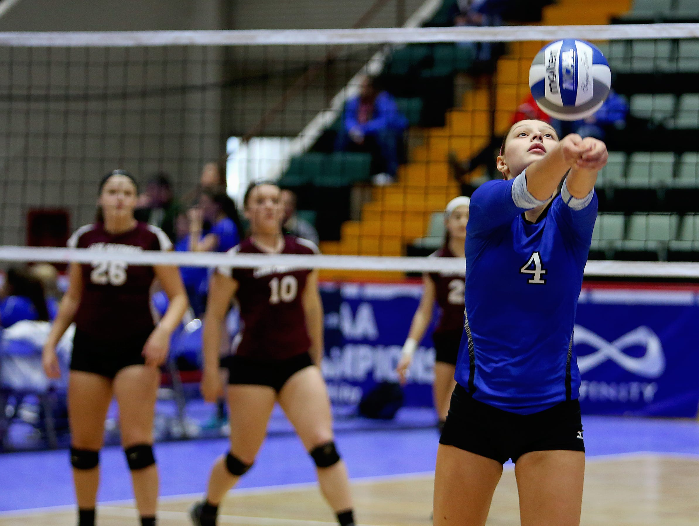 Haldane's Brooke Vahos bumps the ball during Haldane's two-game loss to Portville at the state volleyball championships on Saturday, Nov. 21, 2015, at the Glens Falls Civic Center.