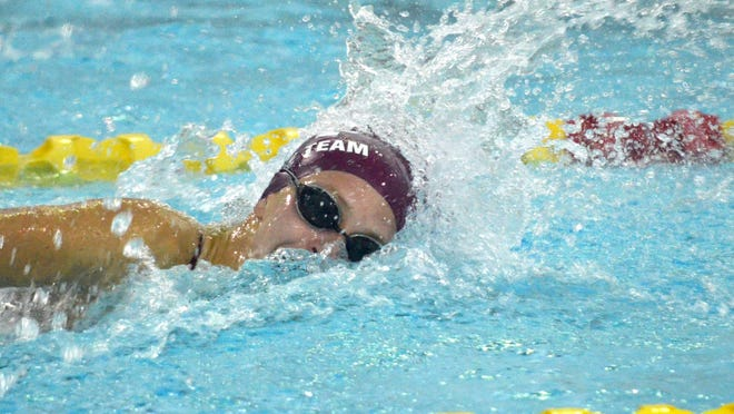 Holland Christian's Meghan Bengelink swims the 50 freestyle on Tuesday at Holland Community Aquatic Center.