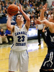 Megan Herr of Carroll puts up a shot in front of Liby Bonner in the girls basketball sectional #38 Saturday, February 4, 2017, in Lafayette. Carroll defeated CC 35-30.