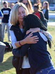 "Makayla Smith (right) hugs Bianka Landavazo after unveiling the Mane Event horse ""Forever"" outside McNiel Middle School."