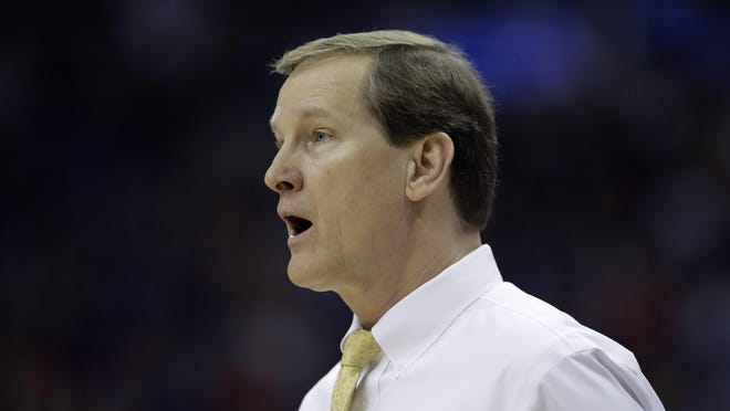 Oregon head coach Dana Altman watches from the bench during the second half of a regional final against Kansas in the NCAA men's college basketball tournament, Saturday, March 25, 2017, in Kansas City, Mo.