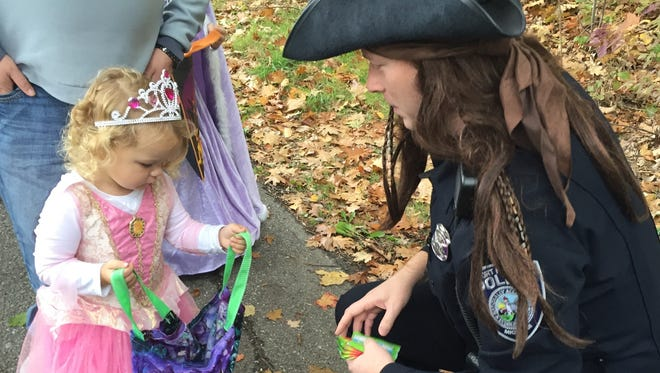 Port Huron police officer and pirate Patrick Eash hands out candy to a princess during the 2016 Sanborn Park Halloween Stroll. This year's event is 10 a.m. to 1 p.m. today.