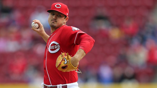 Cincinnati Reds starting pitcher Tyler Mahle (30) delivers in the first inning during the National League baseball game between the Chicago Cubs and the Cincinnati Reds, Monday, April 2, 2018, at Great American Ball Park in Cincinnati.