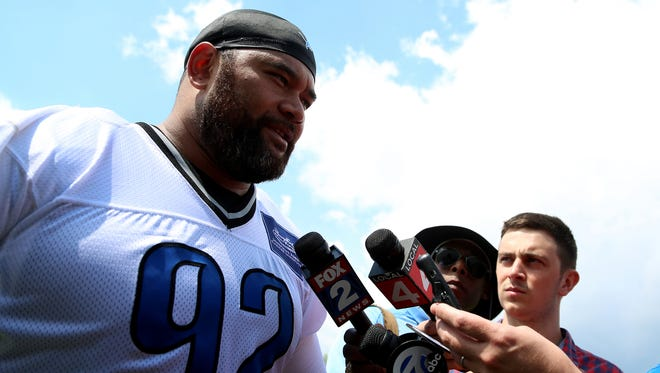 New Detroit Lions defensive lineman Haloti Ngata answers questions from the media after practice in Allen Park on Wednesday, May 27, 2015.