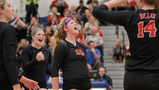 West Branch's Bailey Lukavsky celebrates with teammates during the Bears' game in West Liberty on Tuesday, Oct. 6, 2015.