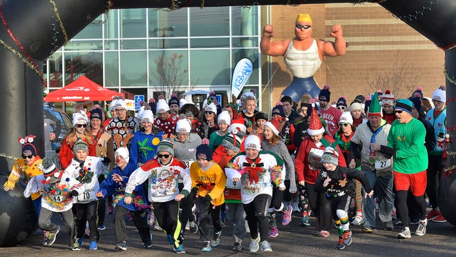 Participants leave the starting line in the first 104.7 KCLD Ugly Sweater-A-Thon 5K on Saturday, Dec. 5 at St. Cloud State University. Organizers say about 300 registered for the inaugural run.