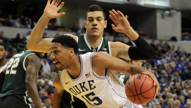 Duke center Jahlil Okafor drives against Michigan State Spartans forward Gavin Schilling in November.