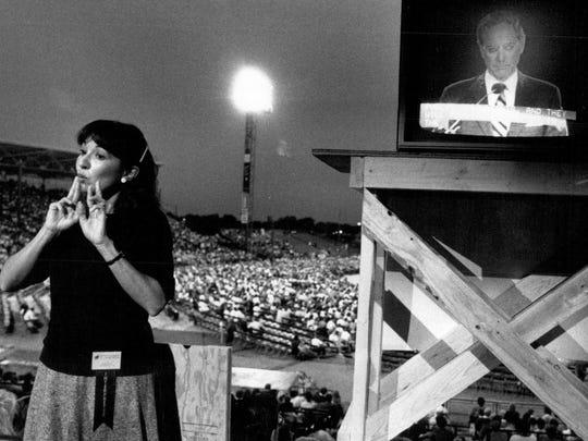 1988 - Rochester: Sandra Bradbury, an interpreter from RIT signing at the Silver Stadium Billy Graham rally in September.