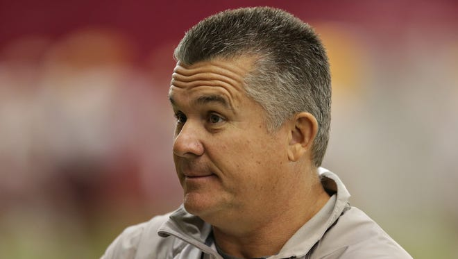 ASU head coach, Todd Graham talks to players during spring football practice on Arizona State University Tempe campus as seen in Tempe on Mar., 19, 2015