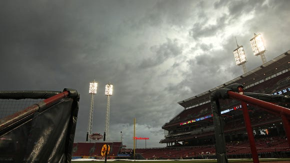 Dark clouds roll over the field during a rain delay prior to Monday night's game.
