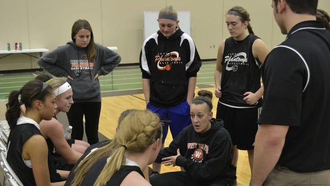 West De Pere girls basketball coach Ashley Anthon, shown during a December 2013 practice, is one of the coaches who feels balance is crucial when utilizing the new summer contact rules.
