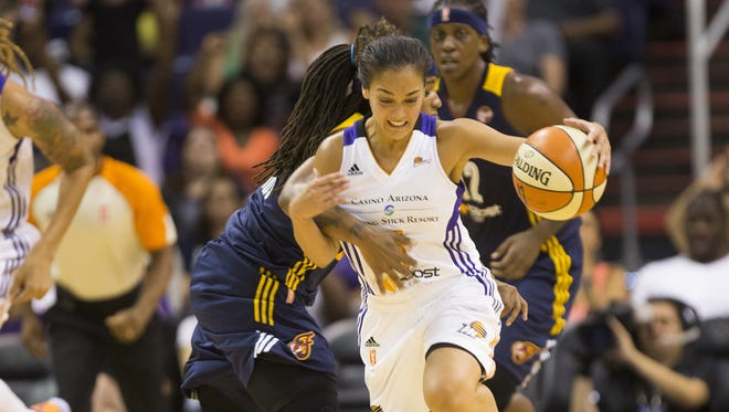 Phoenix Mercury guard Leilani Mitchell is fouled by Indiana Fever guard Shevonte Zellous during the second quarter at US Airways Center in Phoenix, Ariz. August 16, 2015.