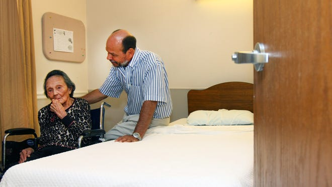 Randall Kaump visits his mom, Janis, 97, in her $13,000-a-month nursing home shared room.