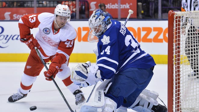 Detroit Red Wings forward Darren Helm, left, plays against the Toronto Maple Leafs on Nov. 6, 2015.
