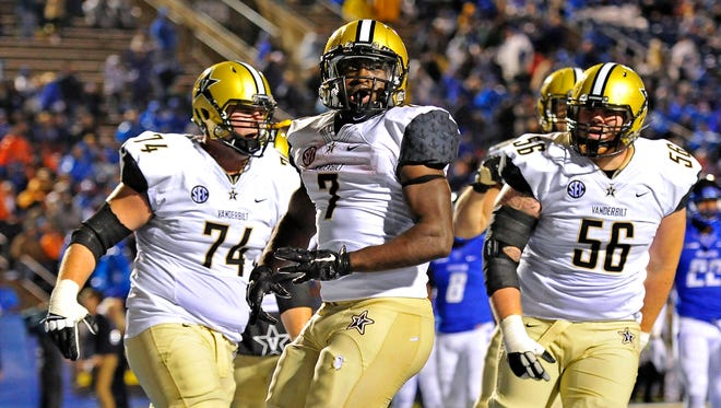 Vanderbilt running back Ralph Webb (7) celebrates his touchdown with offensive tackle Will Holden (74) and center Barrett Gouger during the fourth quarter in a game against MTSU last season. Vanderbilt won 17-13.