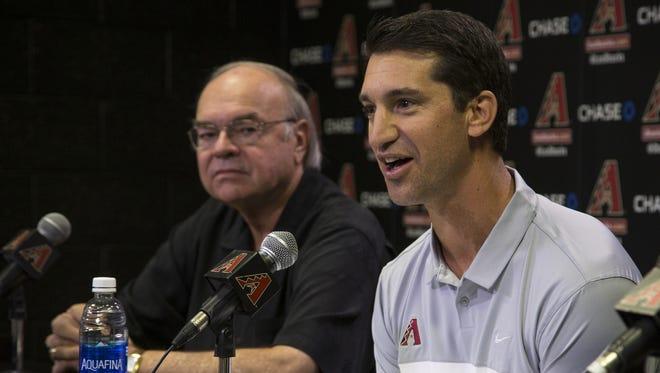 Diamondbacks GM Mike Hazen (right) is introduced to the media last week.