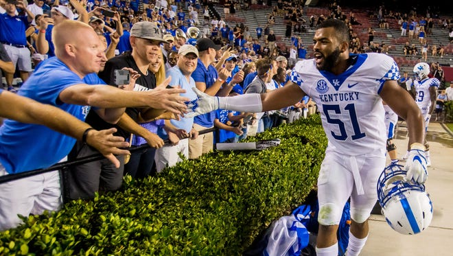 Sep 16, 2017; Columbia, SC, USA; Kentucky Wildcats linebacker Courtney Love (51) celebrates with fans following the Kentucky Wildcats fourth win in a row over the South Carolina Gamecocks at Williams-Brice Stadium. Mandatory Credit: Jeff Blake-USA TODAY Sports