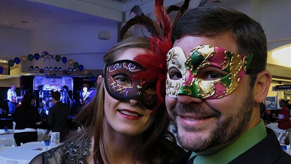 (l-r) Stormie Wallace and Marvin Oliver dawn their Mardi Gras masks for the Cordova Mall Ball.