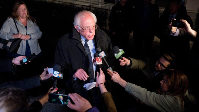 Sen. Bernie Sanders, I-Vt., center, addresses the media at Burlington International Airport on Tuesday night shortly after his loss in the New York Democratic primary.