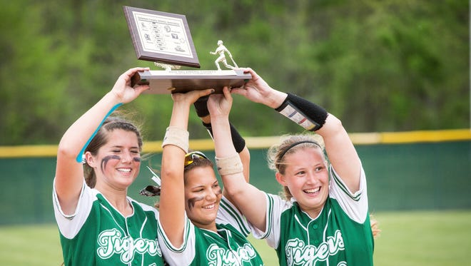 Yorktown's seniors hold up the trophy after a 20-0 win against Wes-Del in the Delaware County Tournament on Saturday at Wes-Del High School.