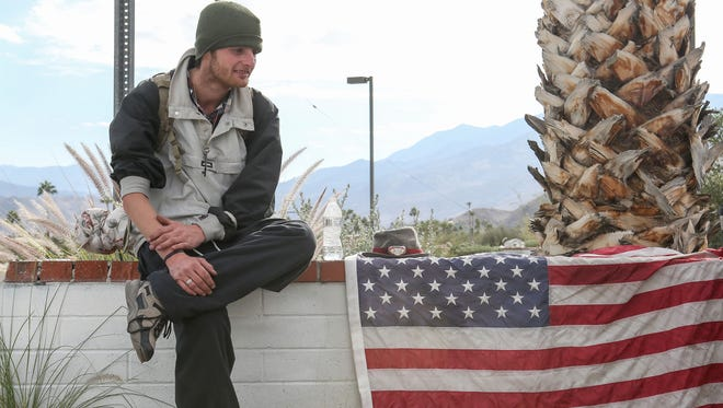 Cody Byrd, who is homeless at 23-year-old, spends time near Sunny Dunes Road in Palm Springs, Dec.1, 2016.