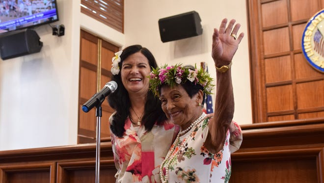 Suruhana Rosalia Fejeran Mateo, or Mama Chai, 81, right, with Vice speaker Therese Terlaje, waves to family and friends during her resolution presentation at the Guam Congress Building on March 23, 2018. Mateo was  presented with Resolution No. 369-34 (COR) for her 62 years of service as a traditional Chamoru healer.