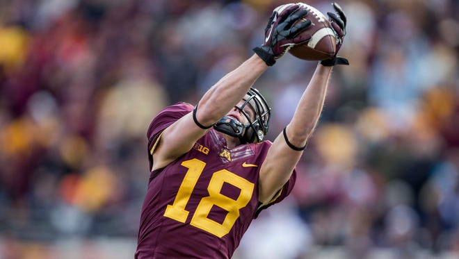 Minnesota wide receiver Derrick Engel (18) catches a touchdown in the second quarter against the Nebraska on Saturday at TCF Bank Stadium.