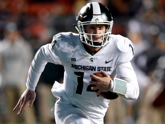 Michigan State quarterback Brian Lewerke (14) rushes against Rutgers during the second half of MSU's 40-7 win on Saturday, Nov. 25, 2017, in Piscataway, N.J.