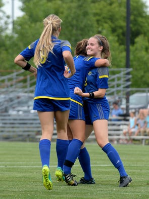 Ellie DeConinck is congratulated by teammates after