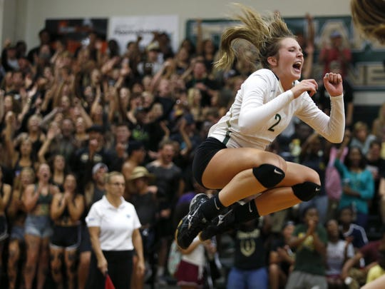 Lincoln's Callie Workman celebrates after her team scores a point against Leon last year. Workman, who is playing libero this season, and fellow senior Madison Fitzpatrick are trying to lead the Trojans to their first district title since 2002.