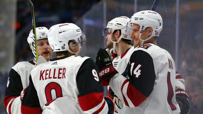 Arizona Coyotes right wing Richard Panik (14) celebrates his goal against the Buffalo Sabres with his teammates during the third period at KeyBank Center.