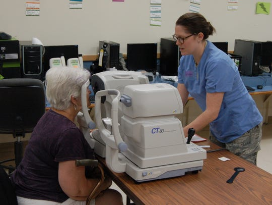 Mary Woodard of Melbourne receives a vision screening