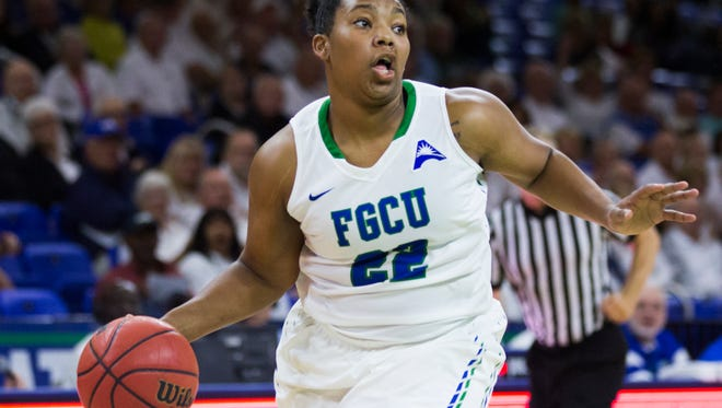 Florida Gulf Coast University junior, China Dow, drives the ball down the court during the women's basketball home opener at Alico Arena in Fort Myers on Tuesday, November 15, 2016. Florida Gulf Coast University beat Florida International University 89 to 42.