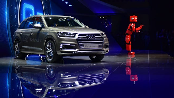 Audi, which recently showed off its e-tron model in Shanghai, is piloting a program in Germany that allows Amazon packages to be delivered by DHL to Audi trunks.
