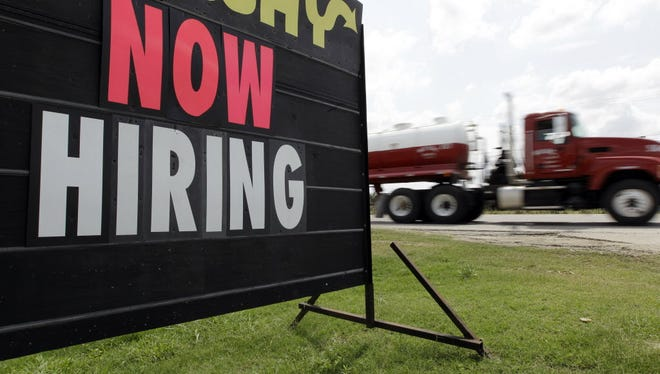 """A """"Now Hiring"""" sign."""