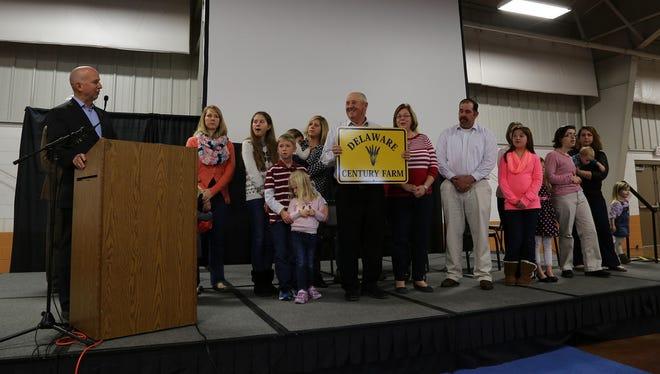 Gov.  Jack Markell honors the Thompson family with a Century Farm designation.