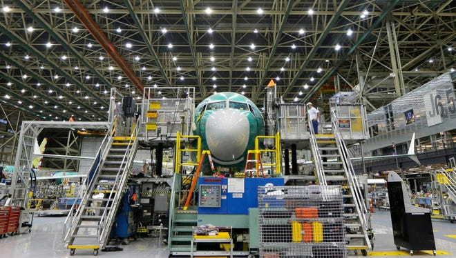 A Boeing 737 MAX airplane being built on the assembly line in Renton, Wash.