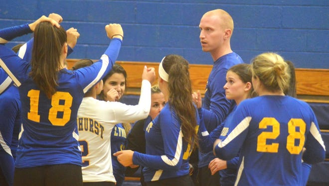 Lyndhurst girls volleyball coach Steve Vahalla talking to his team during a timeout against Immaculate Conception.