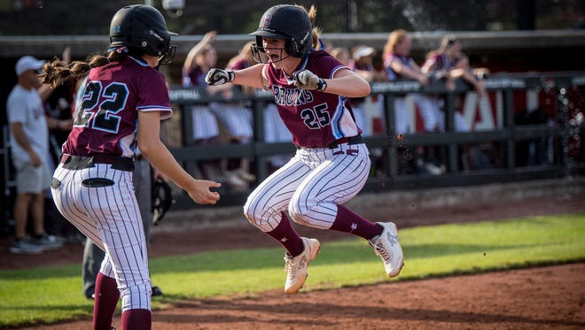 Ballard Bruins Shelby Kelley (25) and Allie Skaggs (22) celebrate after scoring a run during the Seventh Region softball tournament semifinals game 1 against the Male Bulldogs at Ulmer Stadium in Louisville, Kentucky, Wednesday, May 03, 2018.