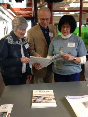 Bernie Daniel, center, president of the North American Bluebird Society, sharesNABS publications during the 2018 Ohio Bluebird Society conferencewithCheryl Corney, left, and Mary Lee Minor.