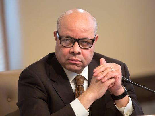 Cincinnati City Manager Harry Black listens to proceedings