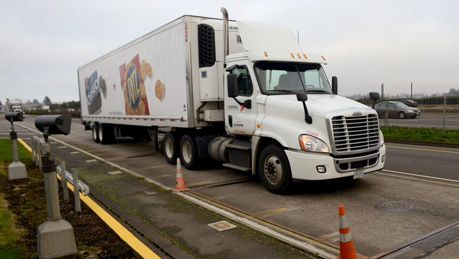 A semitrailer drives onto the scale at the Woodburn Point of Entry on I-5 South on Tuesday, January 6, 2015, in Woodburn. Boones Ferry has been closed to non-local truck traffic after concerns of trucks using the road to avoid the weigh station.