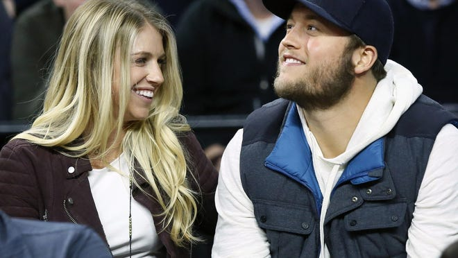 FILE - In this Nov. 17, 2015, file photo, Detroit Lions quarterback Matthew Stafford and his wife Kelly smile while watching the Detroit Pistons play the Cleveland Cavaliers during an NBA basketball game, in Auburn Hills, Mich.